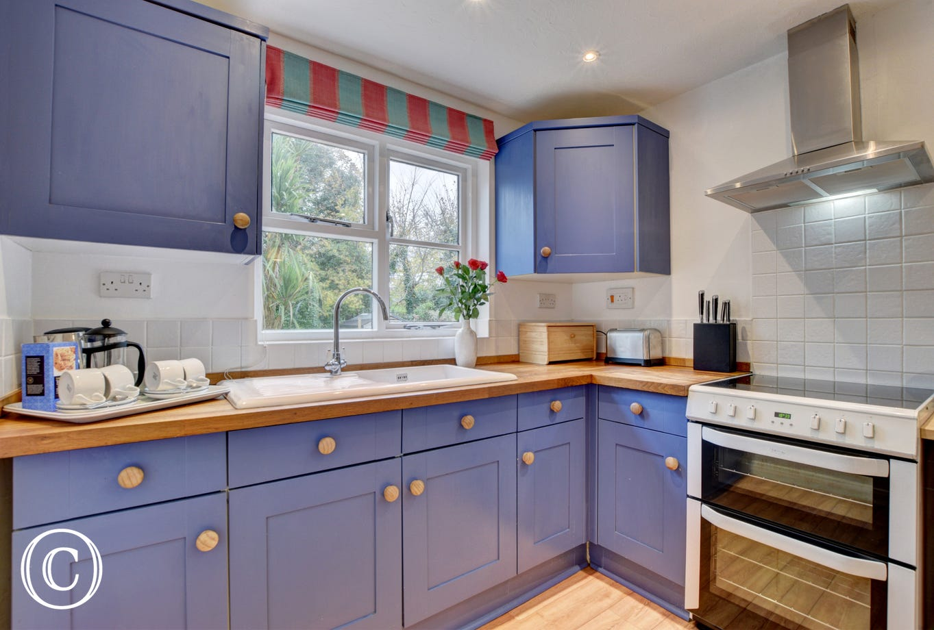 Well equipped kitchen with views to the garden