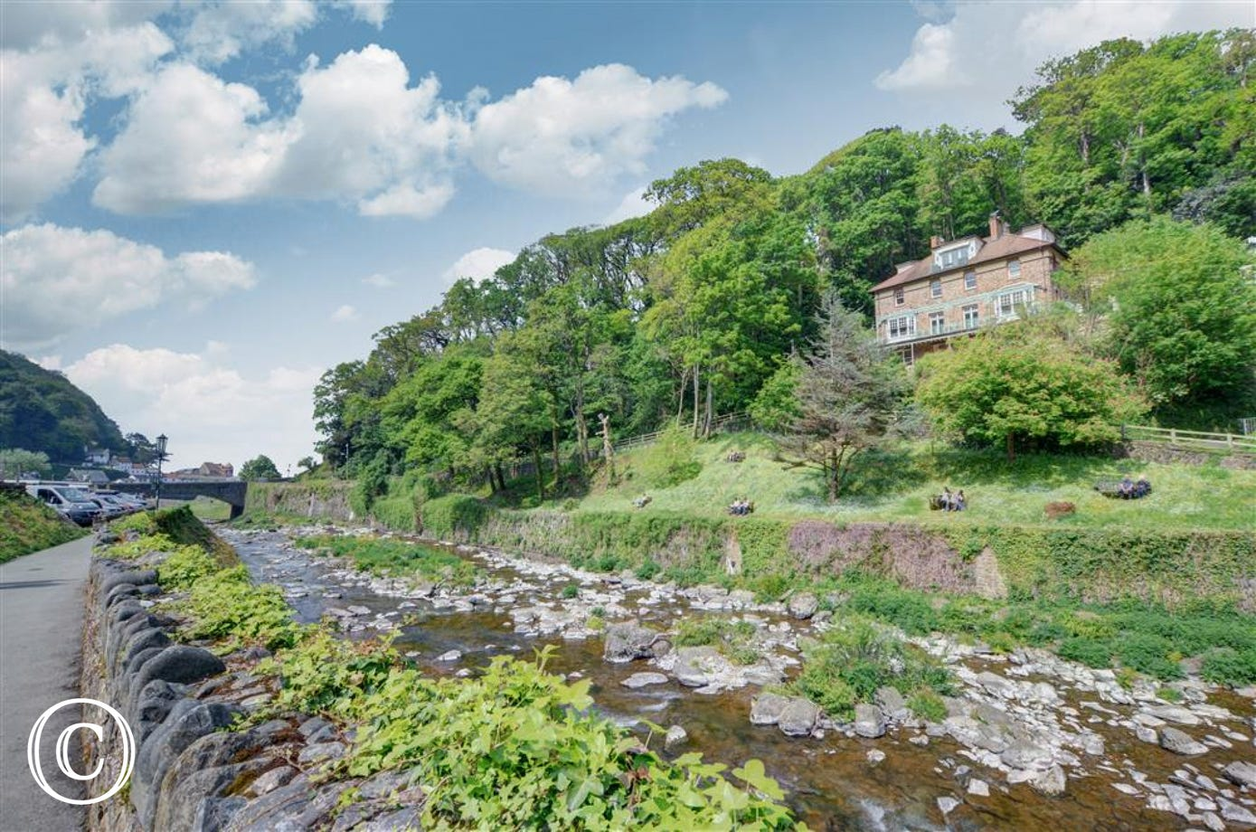 A spacious and attractive apartment offering wonderful river and hillside views