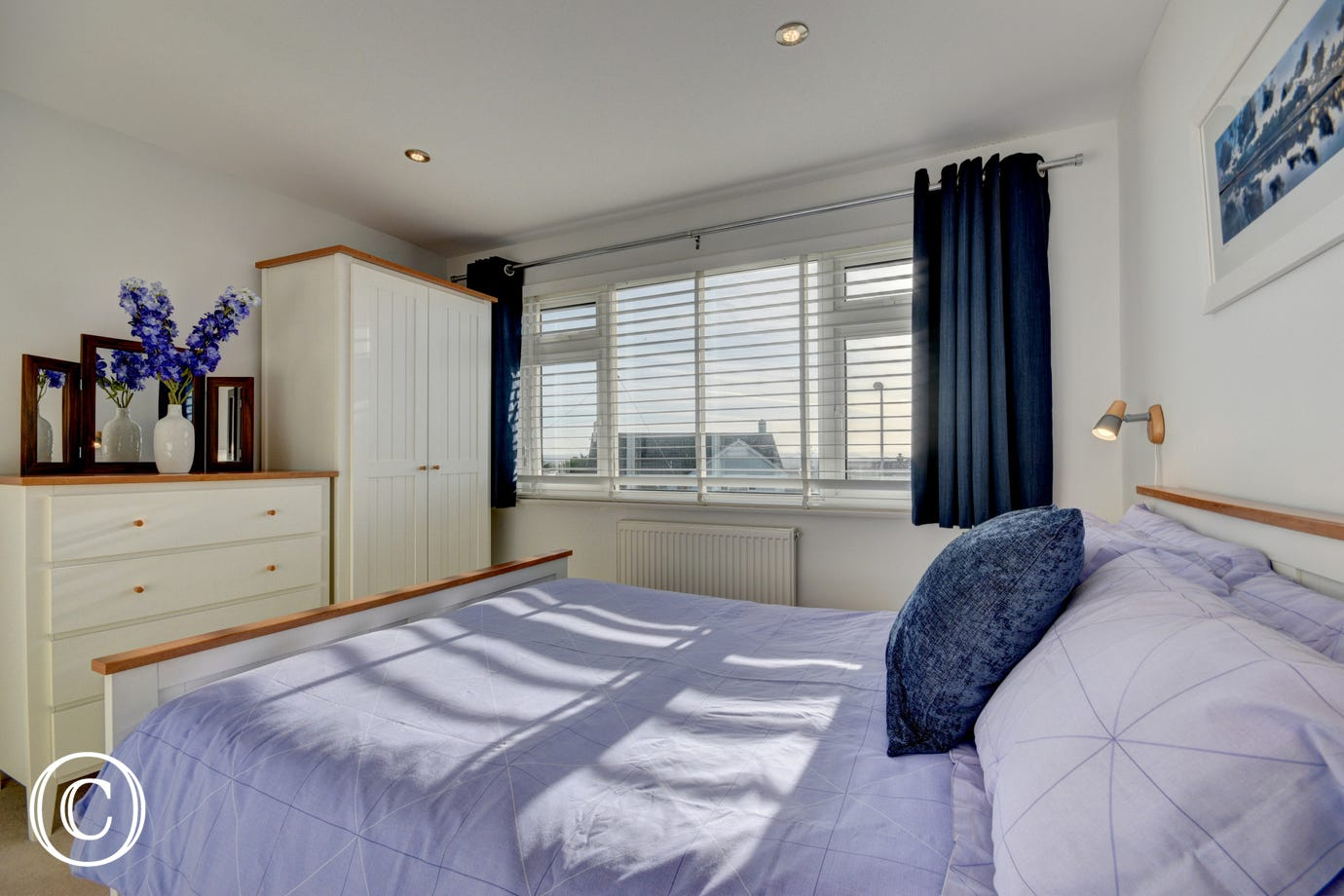 The lovely double bedroom with matching cream furniture