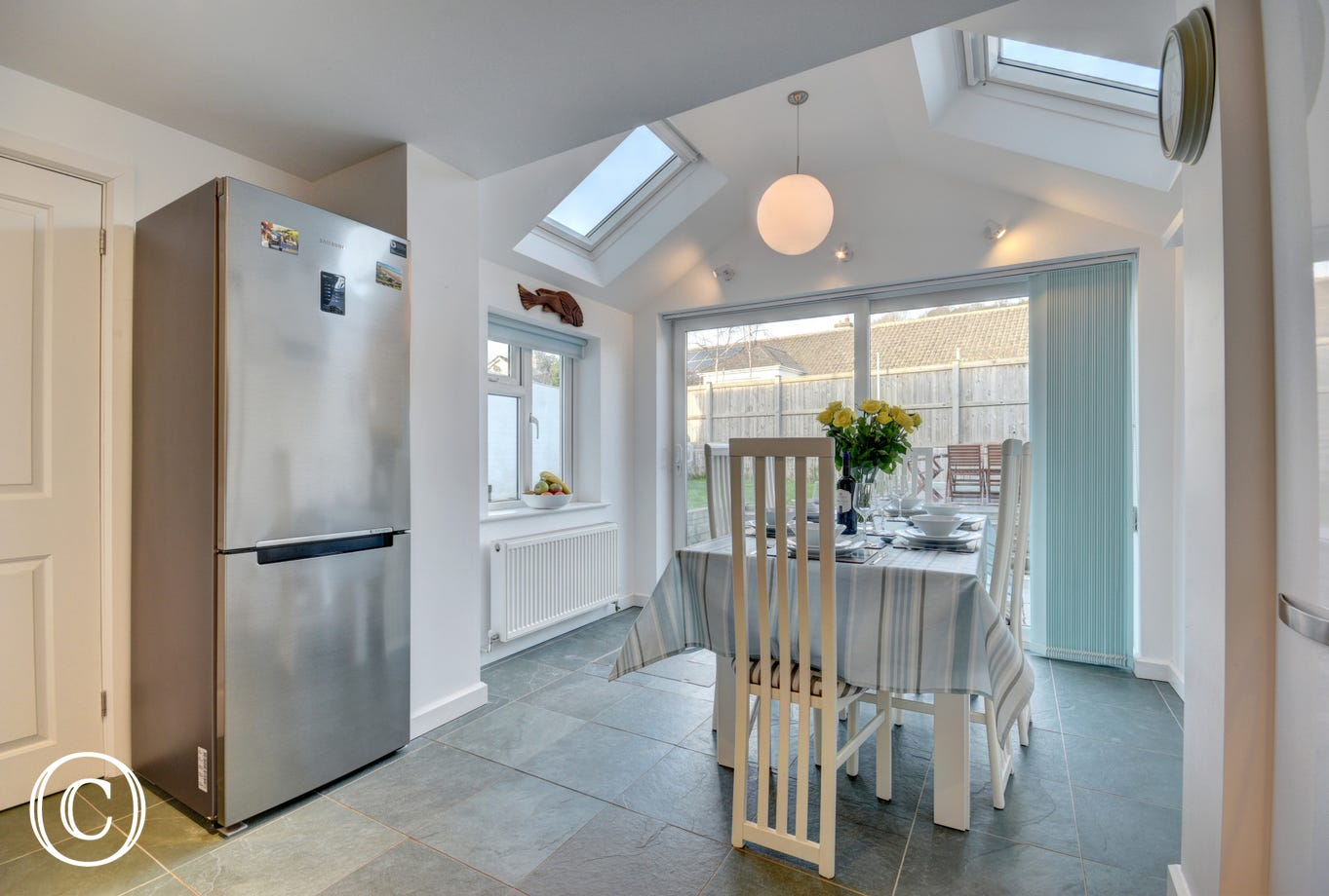 The spacious kitchen with a light and bright dining area extending off towards the garden