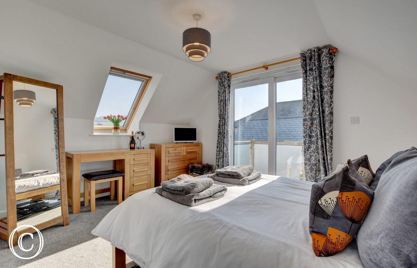 The master double bedroom located on the first floor provides direct access to a decked balcony with fantastic views
