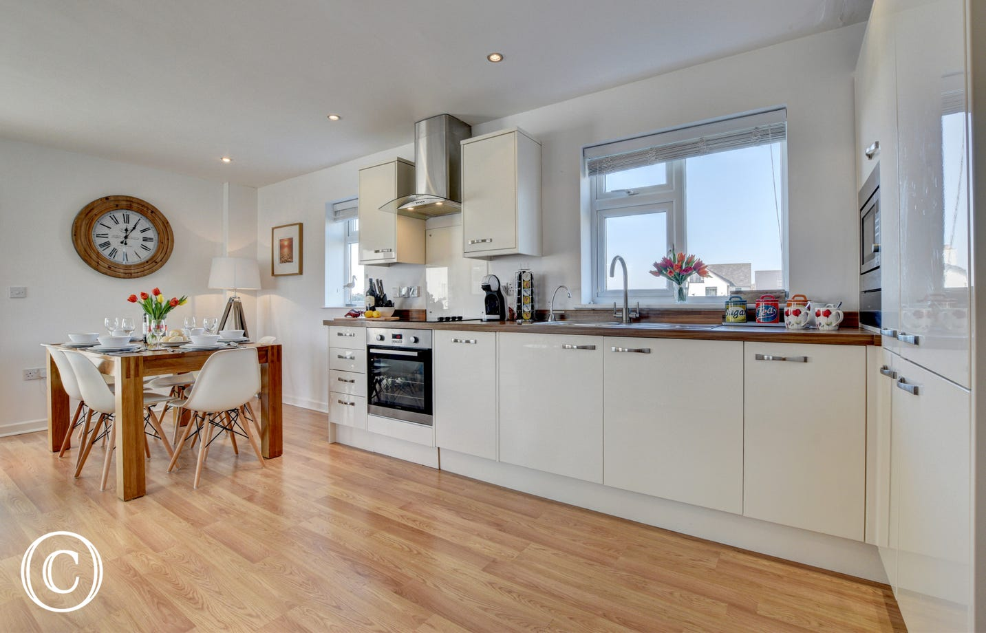 The modern well equipped kitchen and dining area for 6 people make this a great communal area