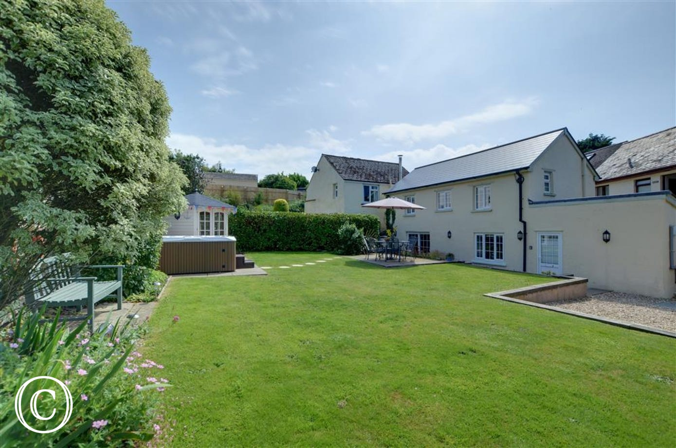 A superb cottage in the centre of the character village of Croyde with ample external space and a hot tub