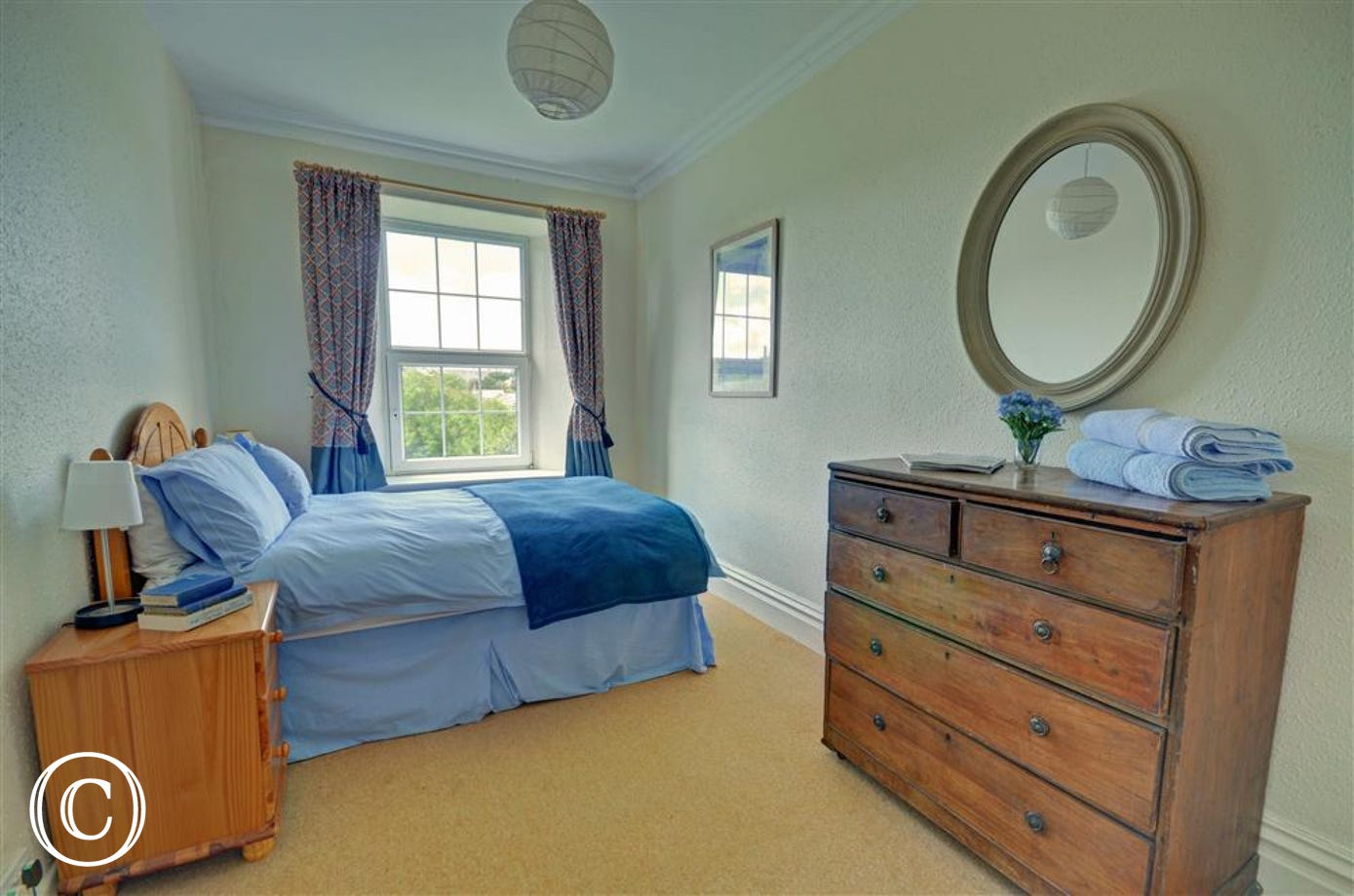 A comfortable and traditionally furnished double bedroom