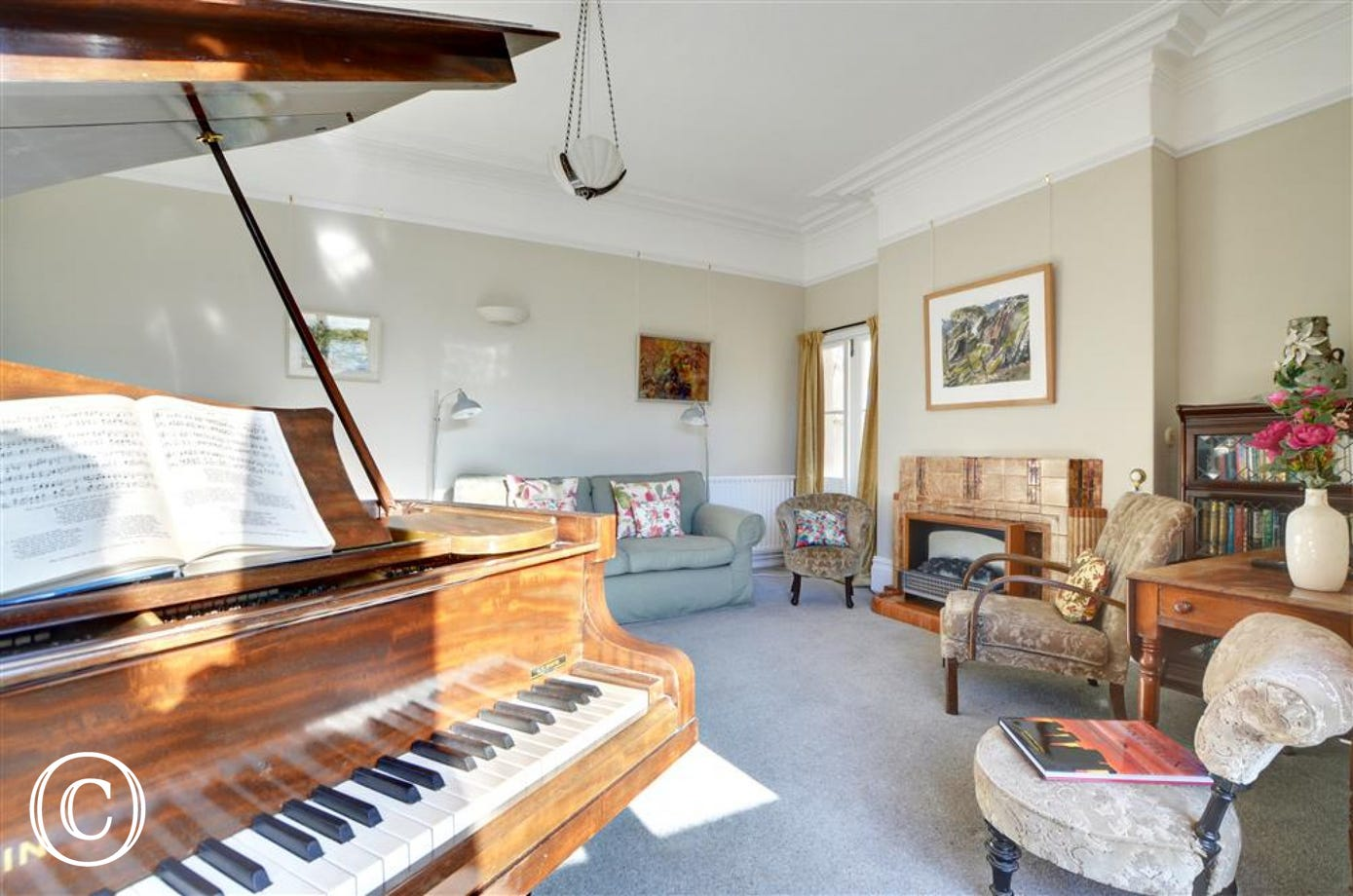 The family have a musical tradition, and guests are invited to play the grand piano in the living room
