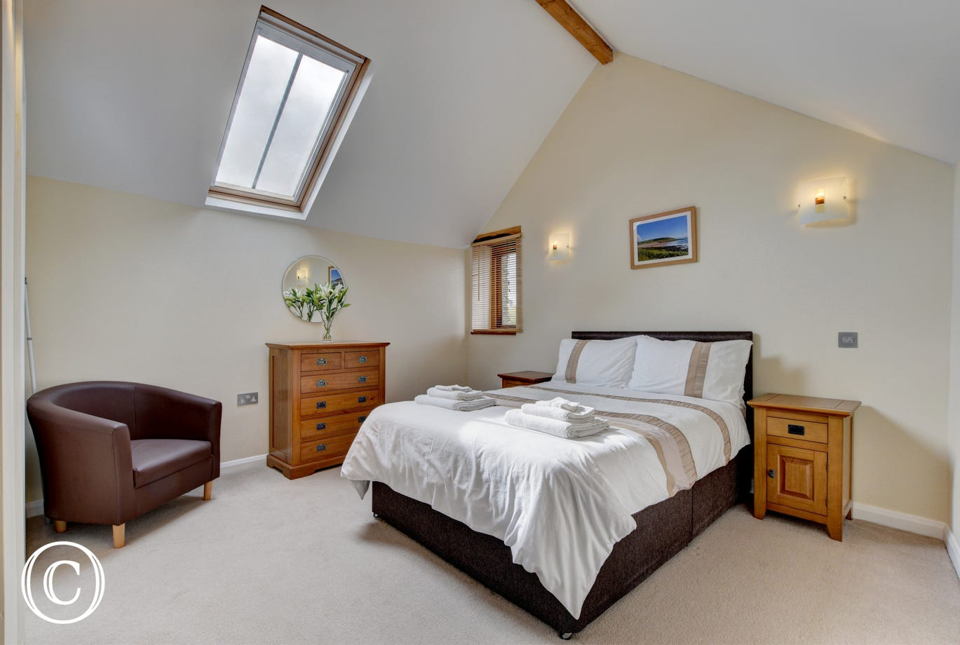 The attractive double bedroom which benefits from a full ensuite bathroom