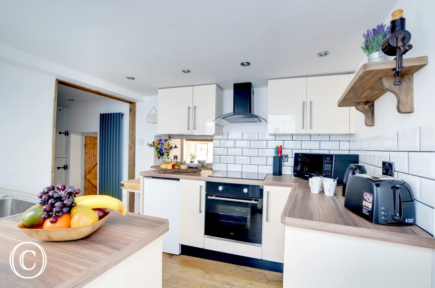 The newly fitted and well equipped kitchen can be found at the rear of the cottage