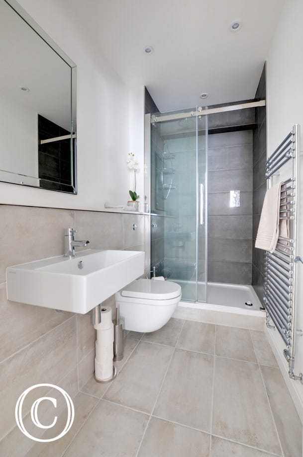 The master bedroom benefits from an ensuite bathroom with large shower