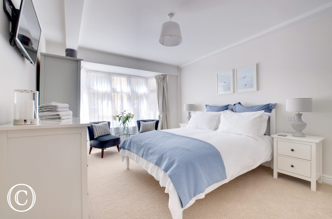 The beautiful master bedroom with ensuite and comfortable seating