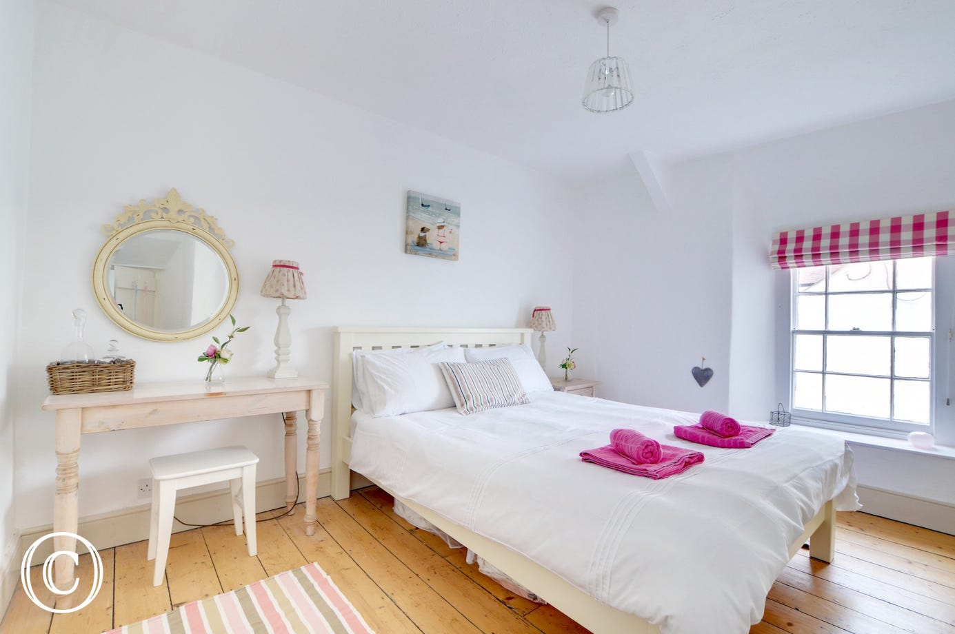 The pretty double bedroom with wooden floors and wonderful views