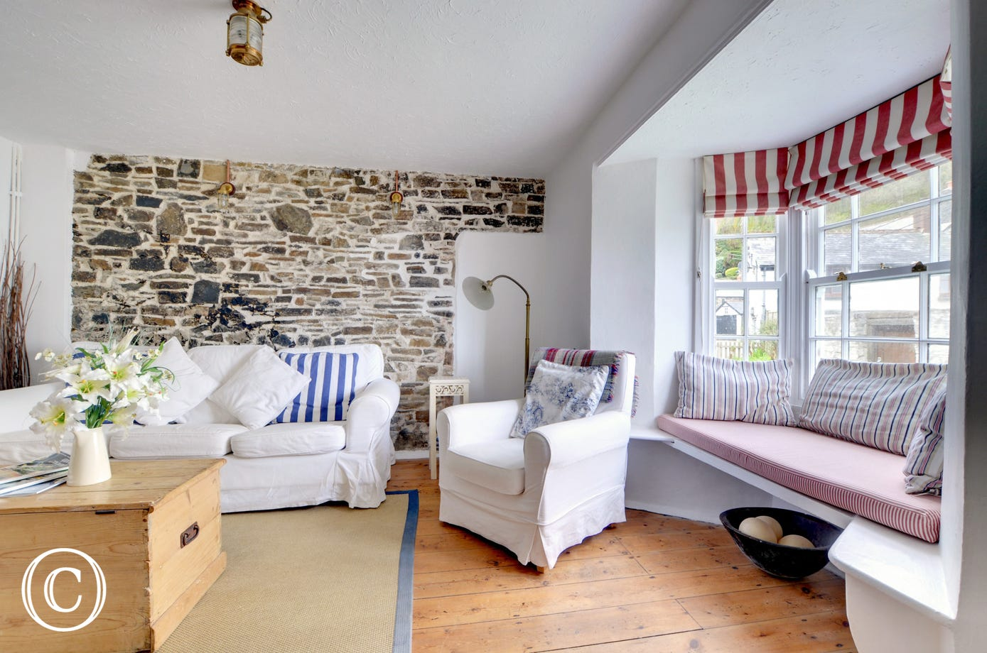 Stone feature wall and alcove seating in the cosy sitting room