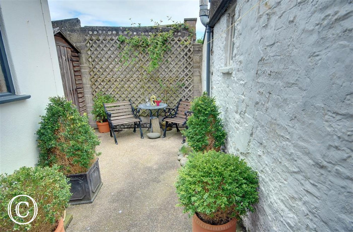 The very private rear courtyard is an ideal spot for leisurely breakfasts or relaxing with a glass of wine on balmy summer evenings