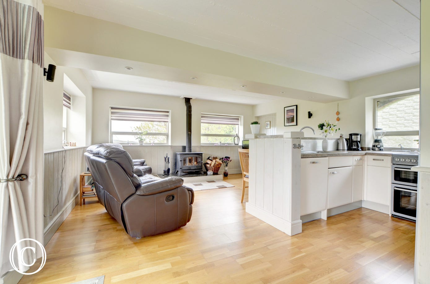The cottage is stylishly decorated with tongue and groove wood panelling and wooden floors