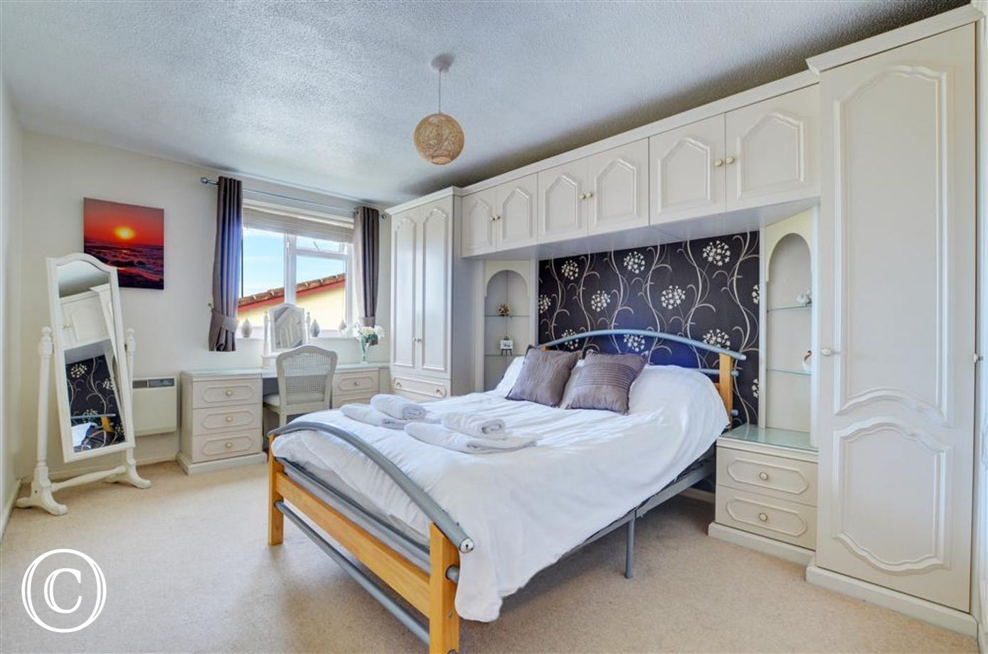 The master bedroom is spacious and has ample wardrobe space for your belongings