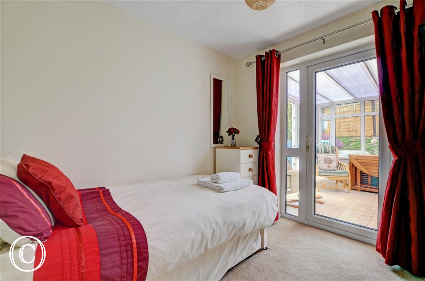 A single bedroom at the rear has a comfortable single pull out bed and leads into a conservatory with additional comfy seating