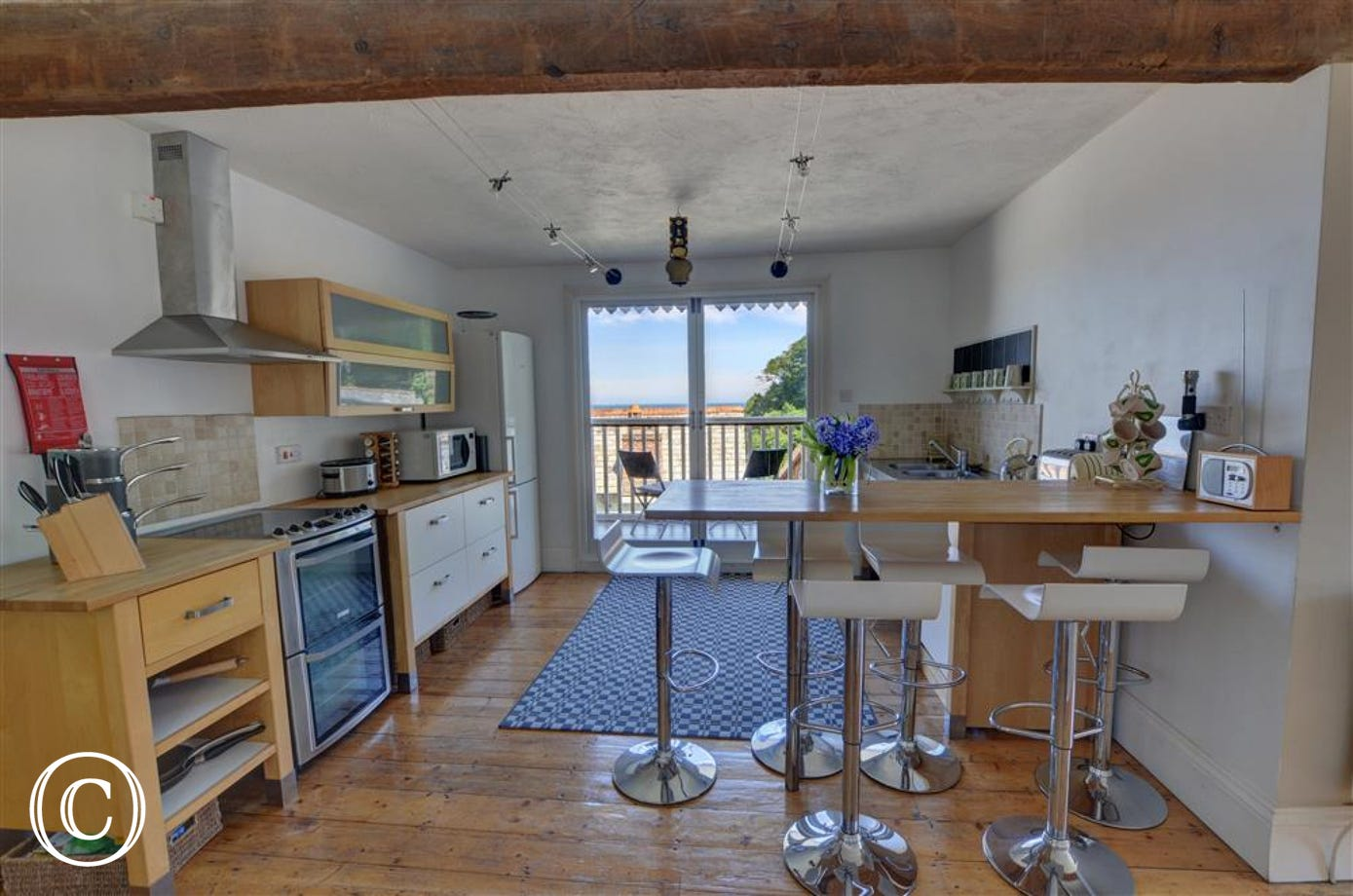 The kitchen benefits from French doors which lead to a larger balcony ideal for BBQs or leisurely breakfasts al fresco.