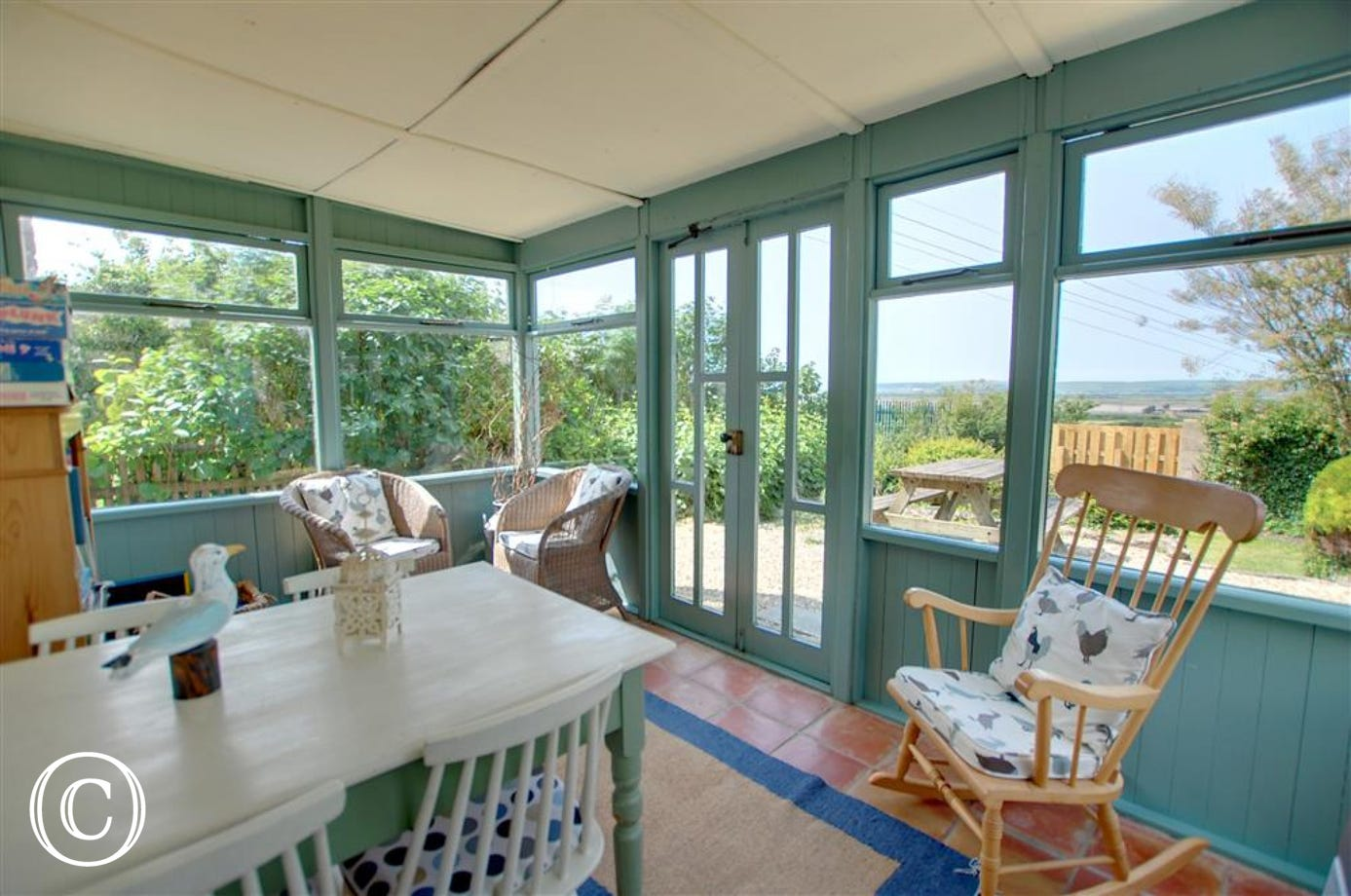 The cottage benefits from a lovely conservatory with doors leading to the patio area
