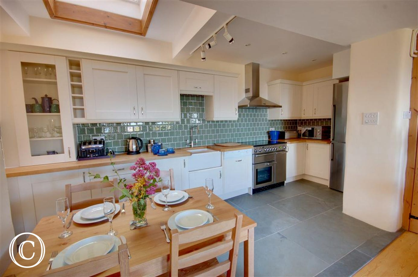 Fully fitted kitchen with tiled floor and all you need
