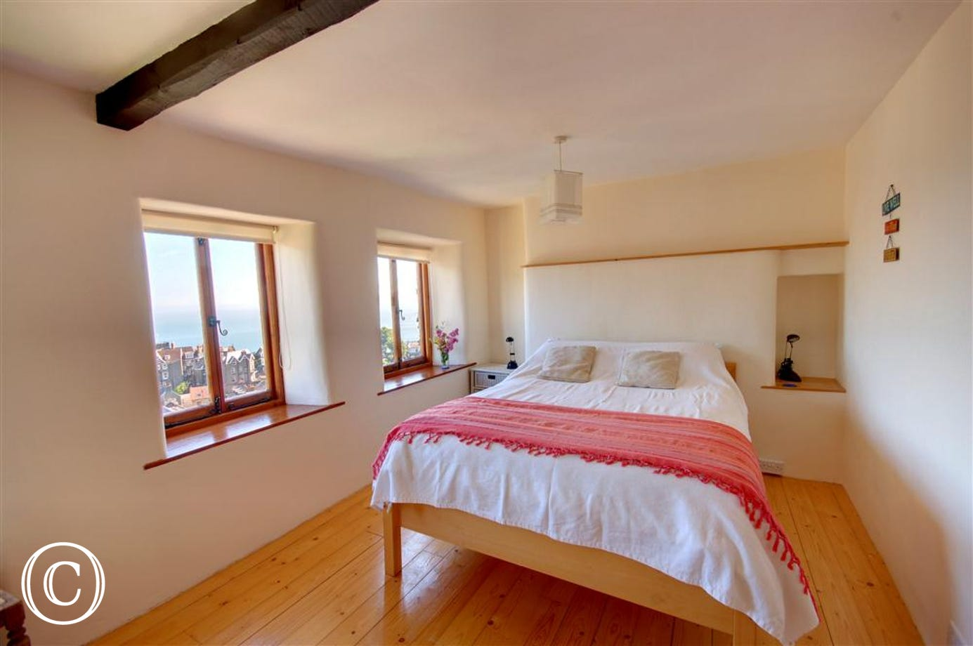 Dual aspect double bedroom with far distant views acorss the valley