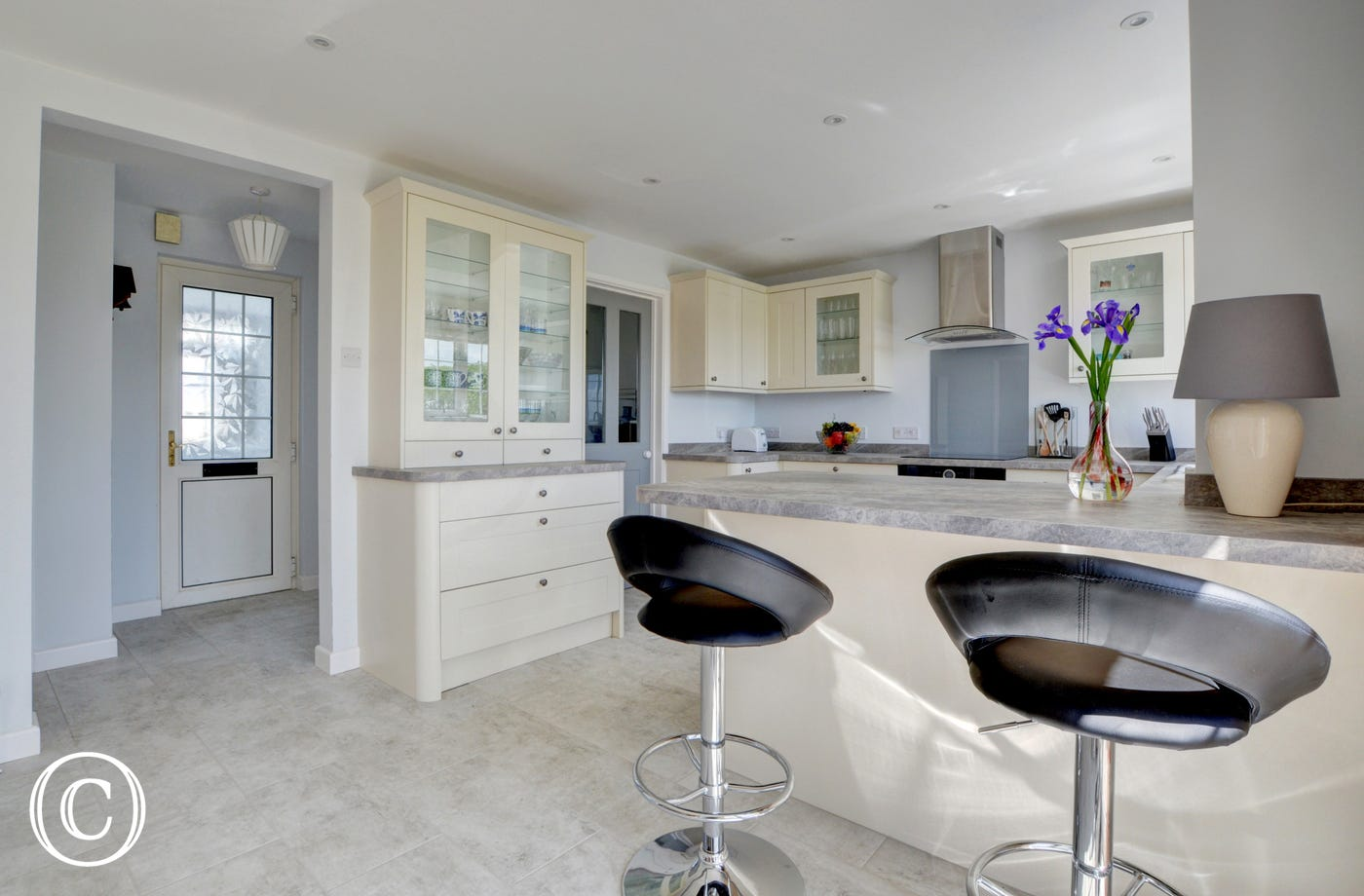 The modern well equipped kitchen area has a small breakfast bar and overlooks the rear garden