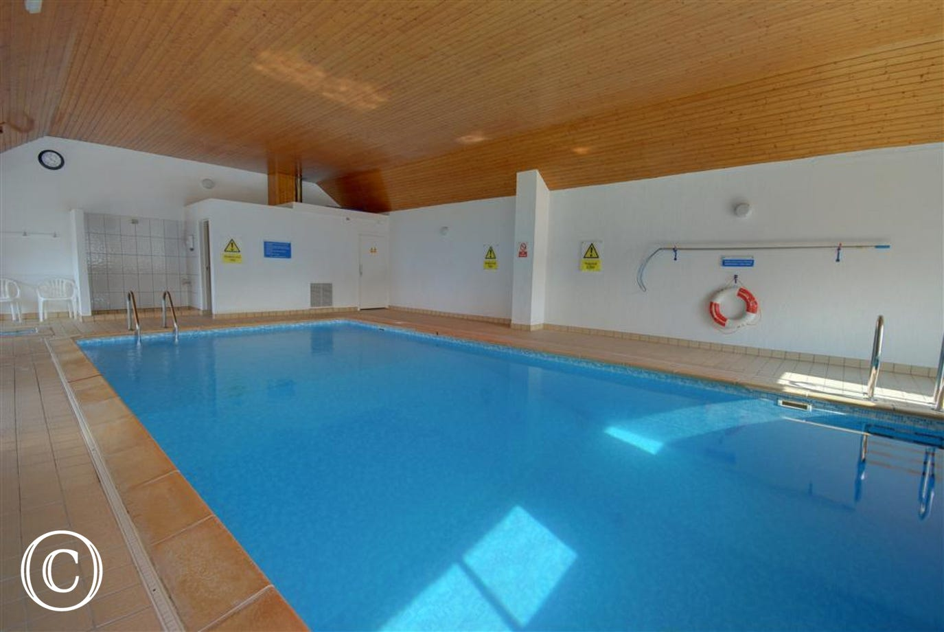 The apartment benefits from an indoor heated swimming pool and separate smaller child's pool
