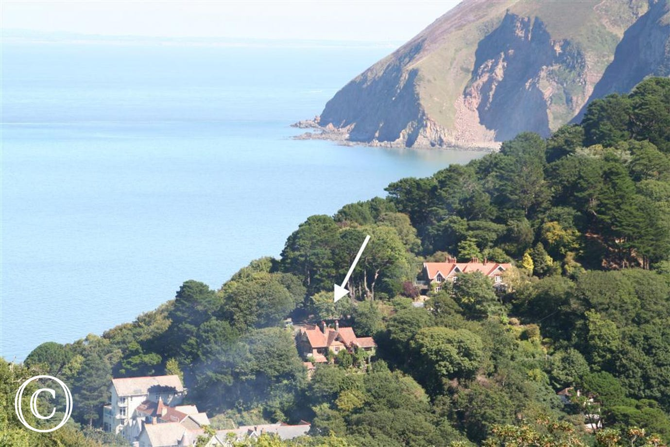 The apartment is located on the top floor of an imposing country house nestling in the wooded hillsides high above the picturesque Exmoor village of Lynmouth