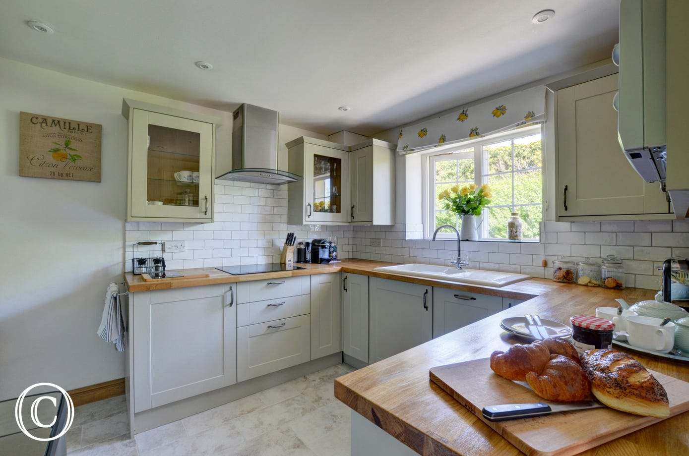The well-equipped 'country style' kitchen has everything you will need for preparing a meal to enjoy inside or al fresco style in the garden