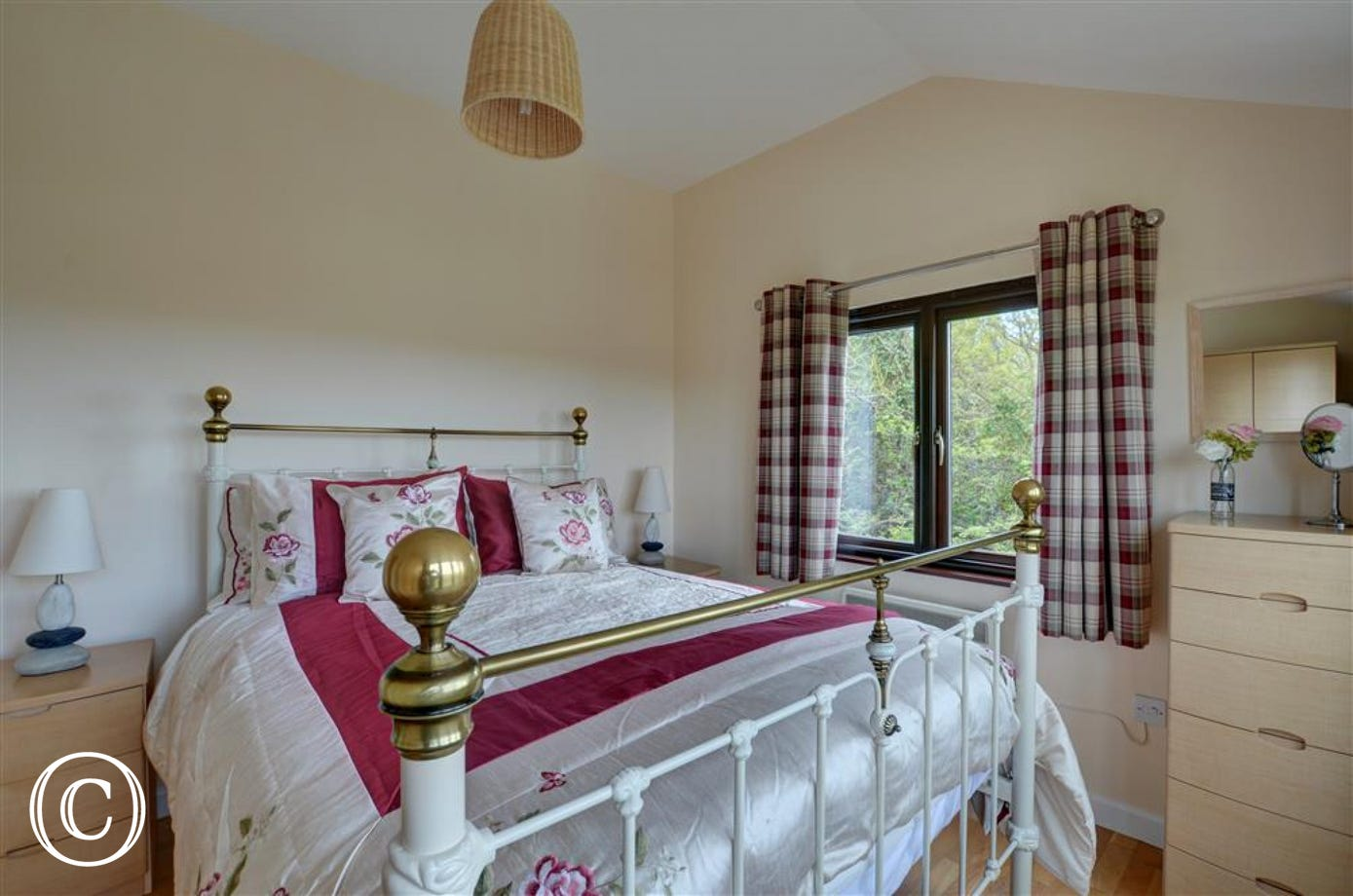The double bedroom leads from the living area and has dual aspect windows to take full advantage of the sea views