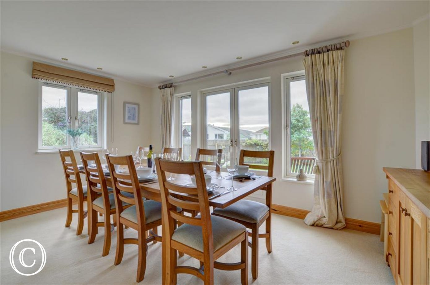 A large separate dining room with French doors also opening to the garden offers a more elegant option for dining