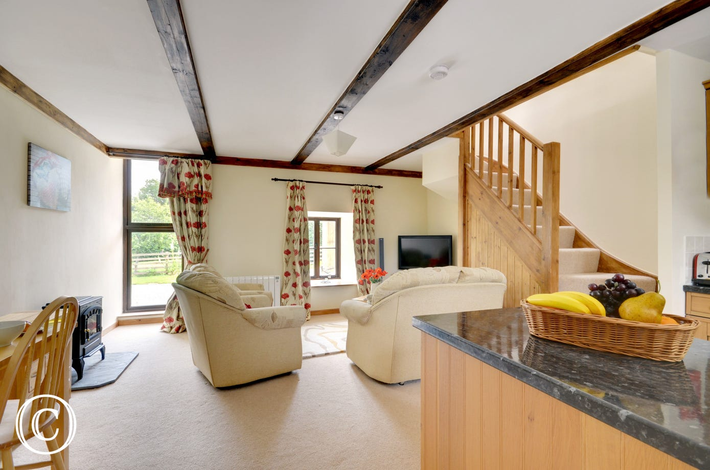 On the ground floor a cosy open plan living and dining room has ample space for relaxation or leisurely meals