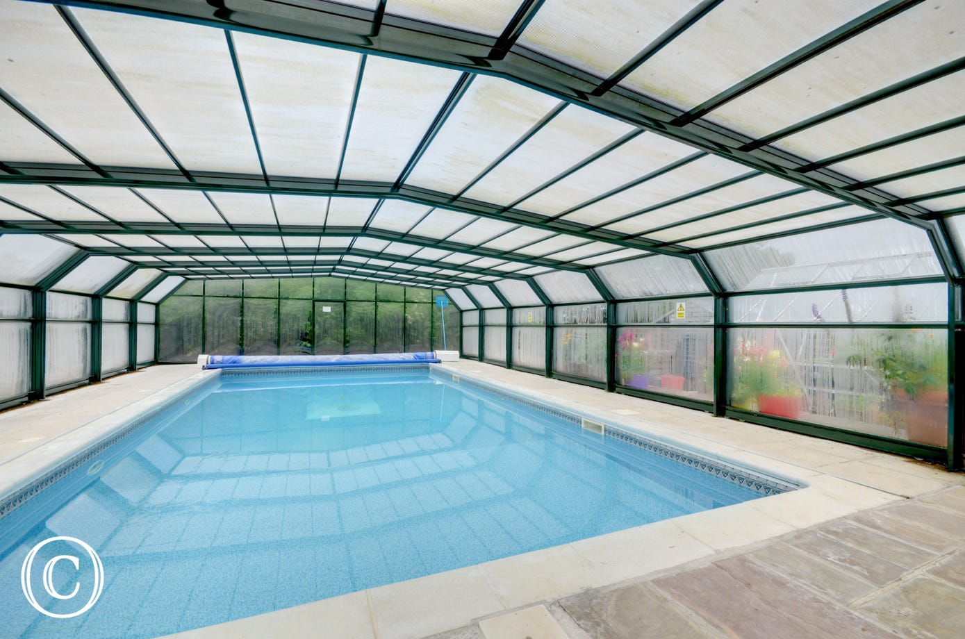 Visitors have shared use of a large indoor heated swimming pool
