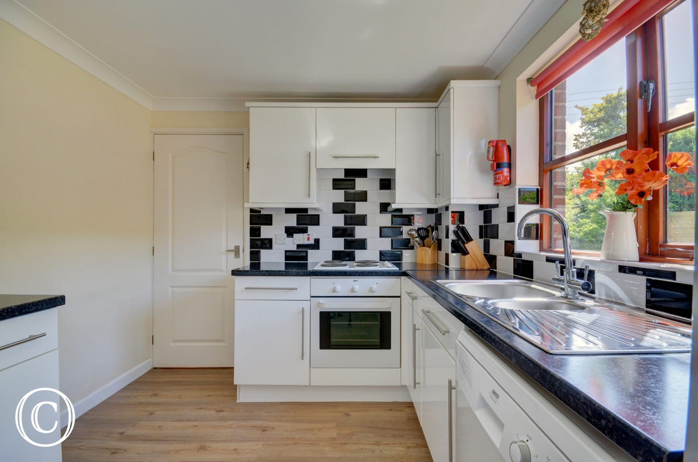 Modern well equipped kitchen which overlooks the garden