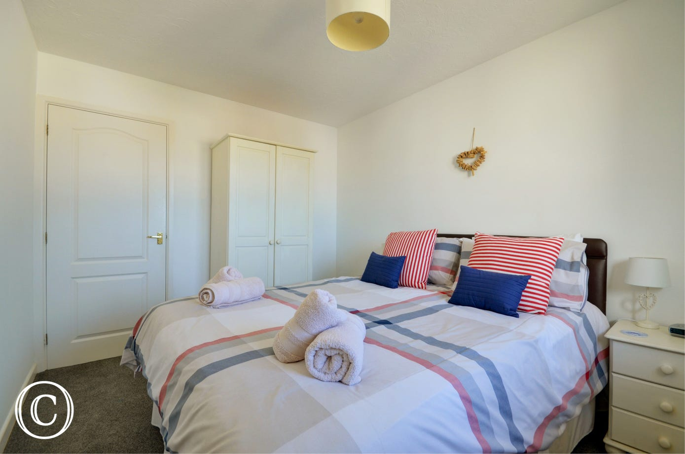 The second double bedroom which also benefits from a kingsize bed