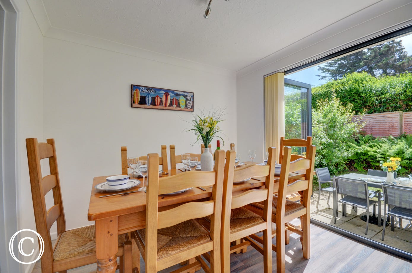 The dining room is light and airy and has patio doors that lead to the rear garden