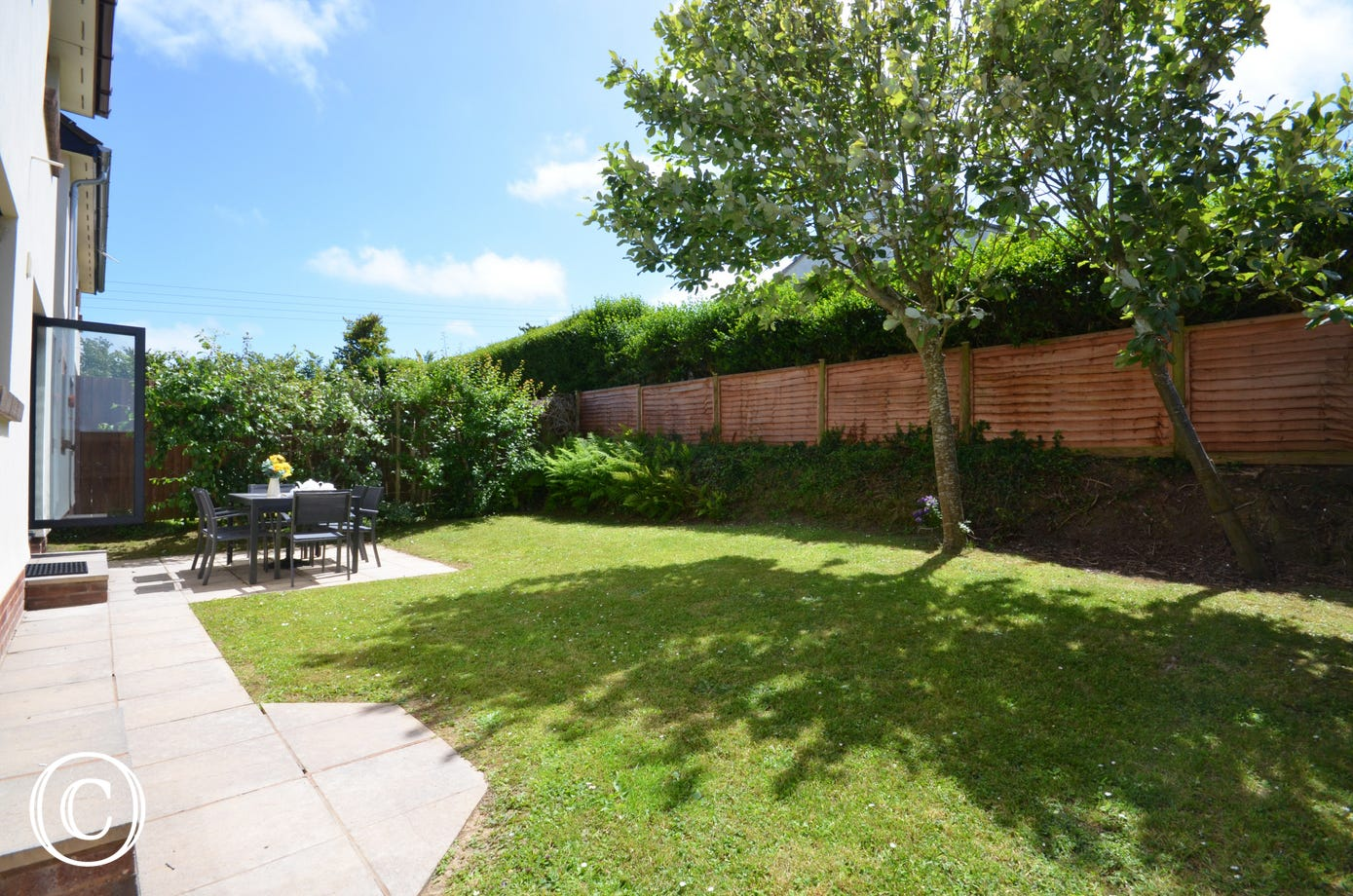 The south facing lawned garden is fully enclosed and offers a perfect retreat at the end of the day