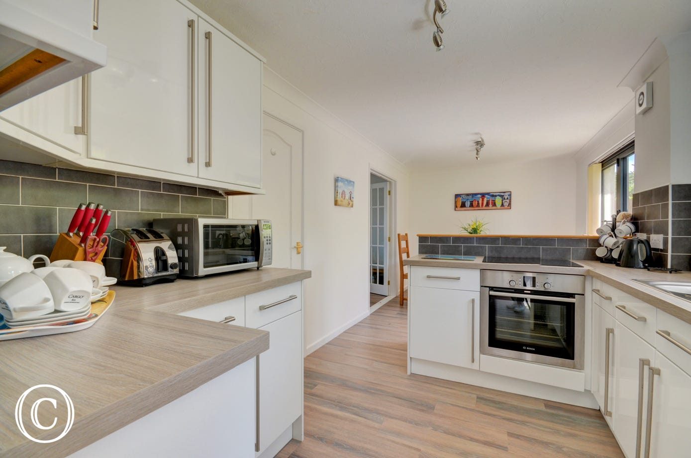 The kitchen/Breakfast Room is modern and bright and benefits from a useful utility room