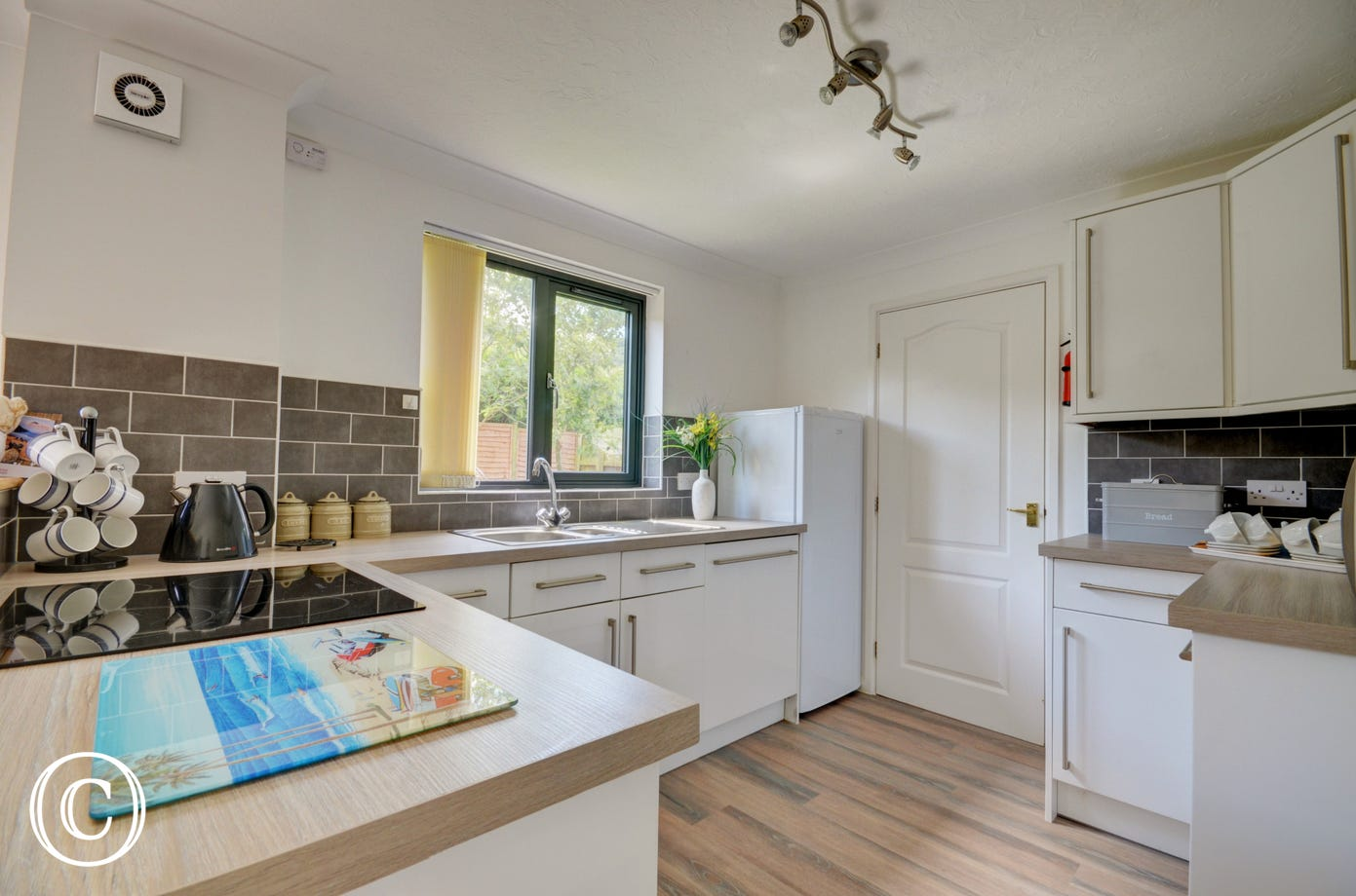 The kitchen is modern and bright and benefits from a useful utility room