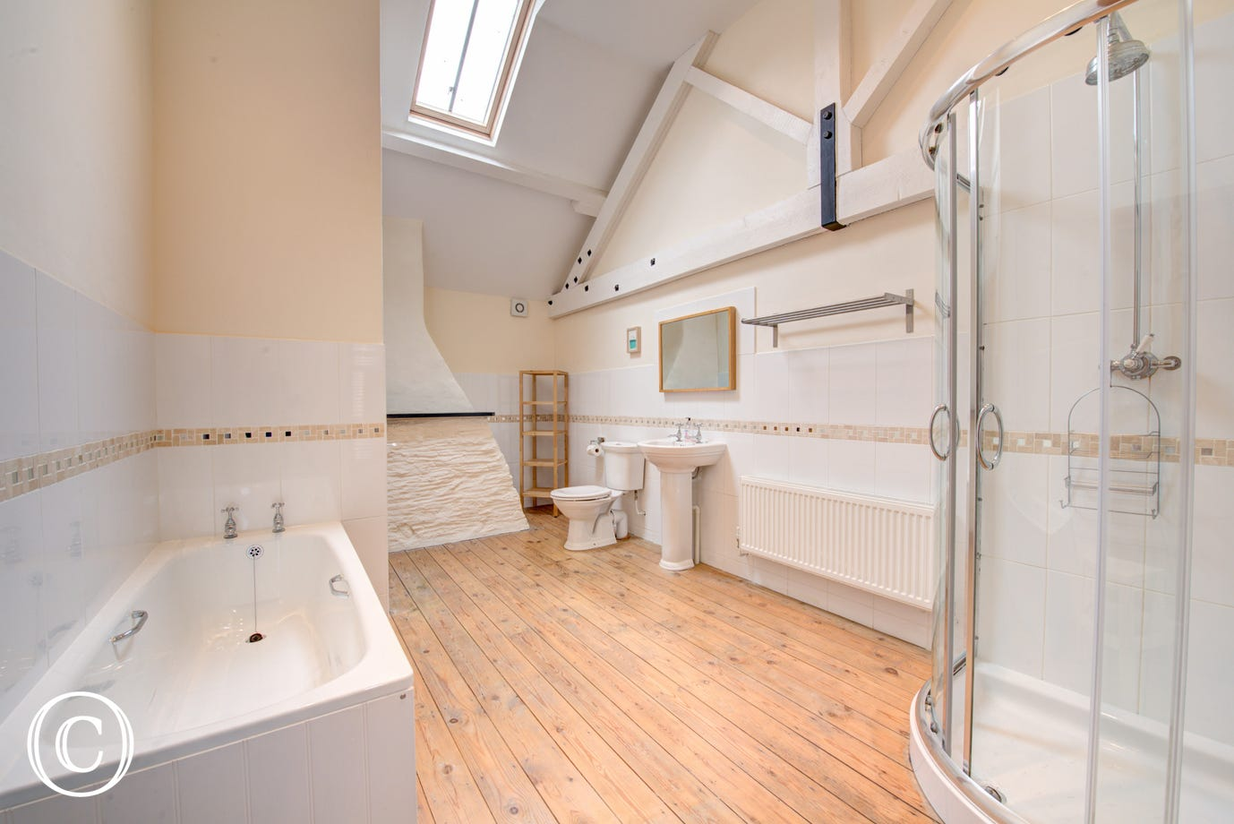 The bathroom is very generously apportioned with both a bath and separate corner powerful shower