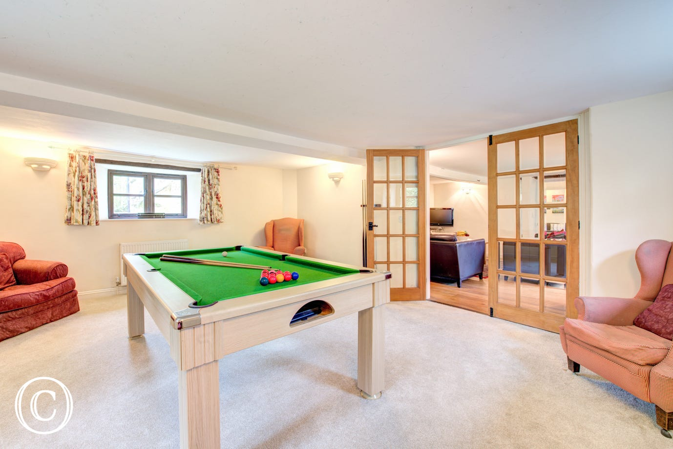 Challenge your friends to a game of Pool in the Pool room