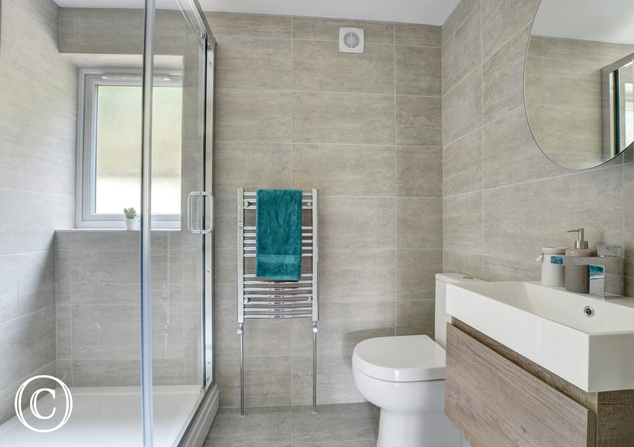 There is also a handy ground floor shower room with WC and separate utility area