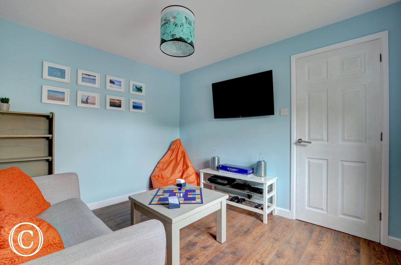 Younger family members will love having their own space in the snug with comfy seating, TV, Blu Ray DVD, game console and a selection of board games