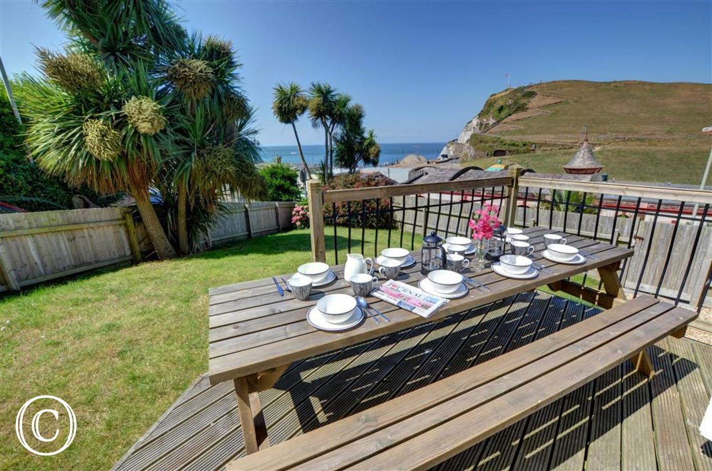 A fantastic spot to have breakfast together - palm trees and sea views!