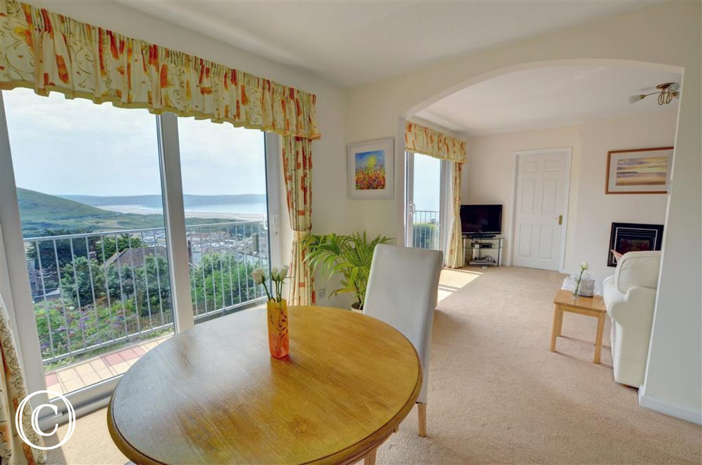 The dining area with patio doors looking towards Woolacombe beach.