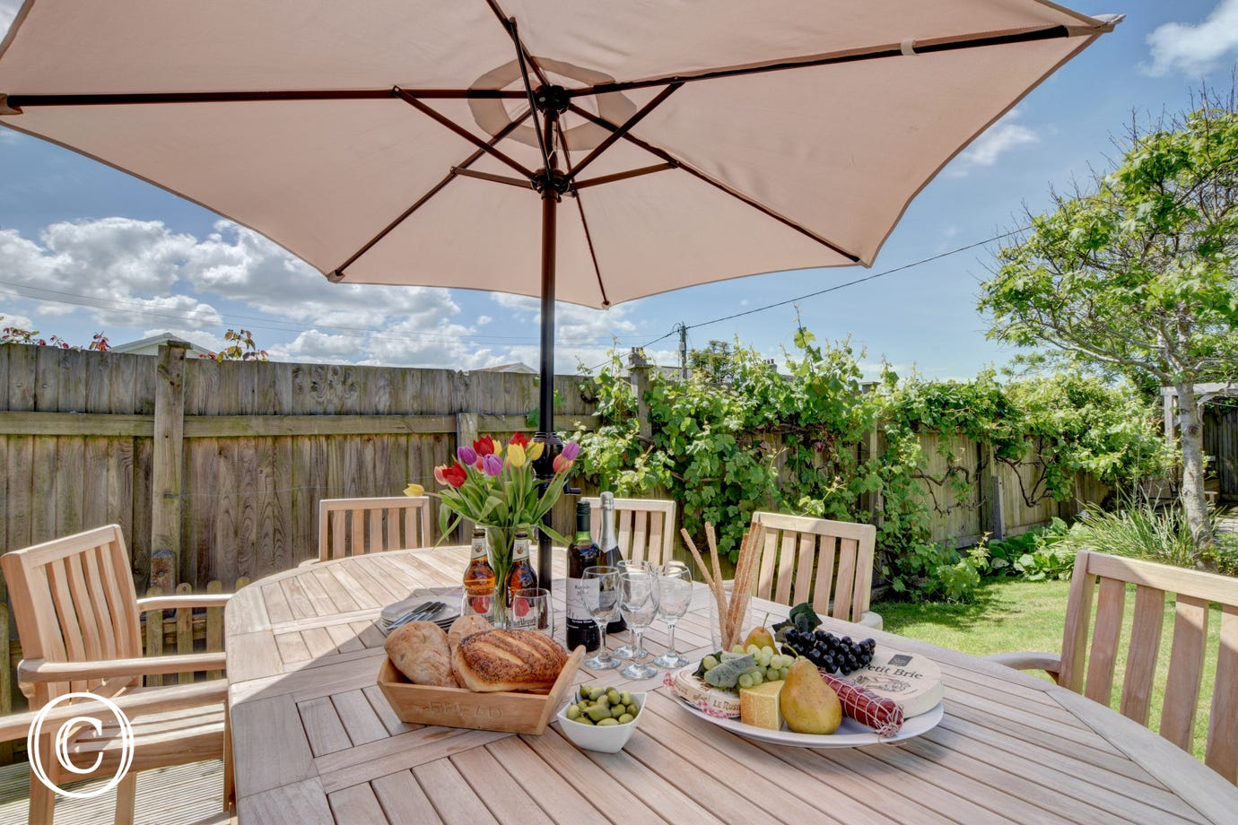 The superb patio area has a large dining table for al fresco dining