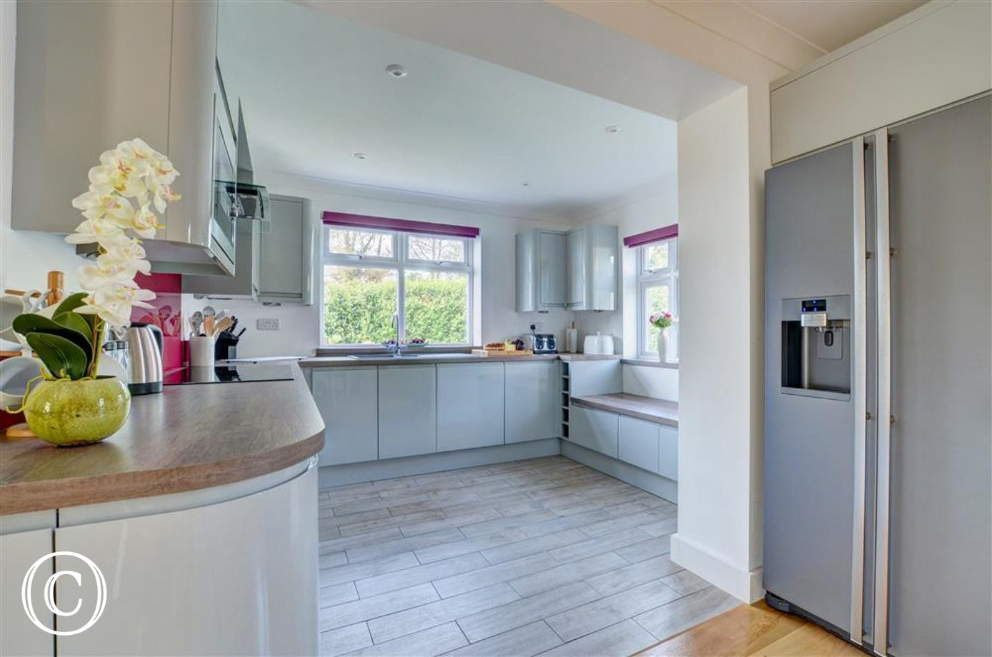 Spacious and contemporary kitchen with huge American style fridge/freezer