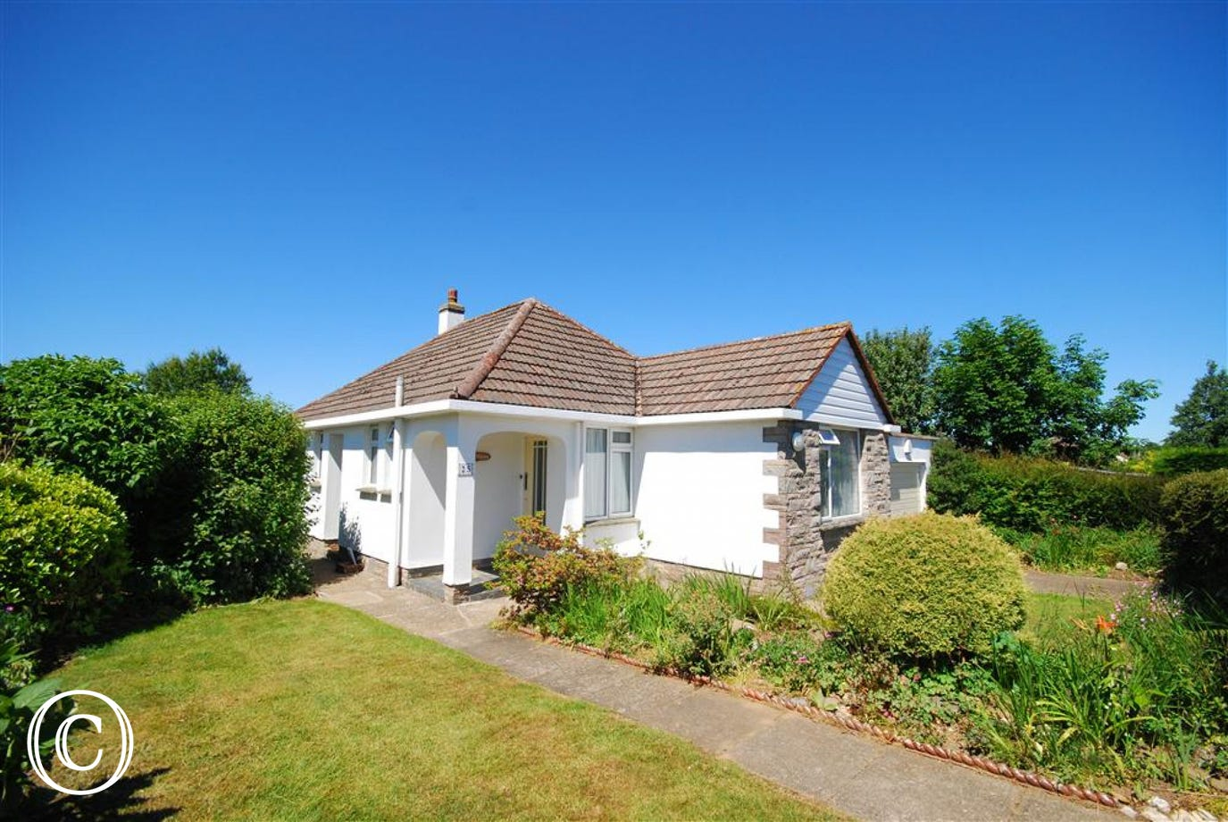 Detached bungalow surrounded by pretty gardens