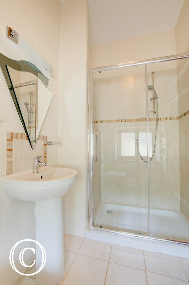 The pristine ensuite shower room