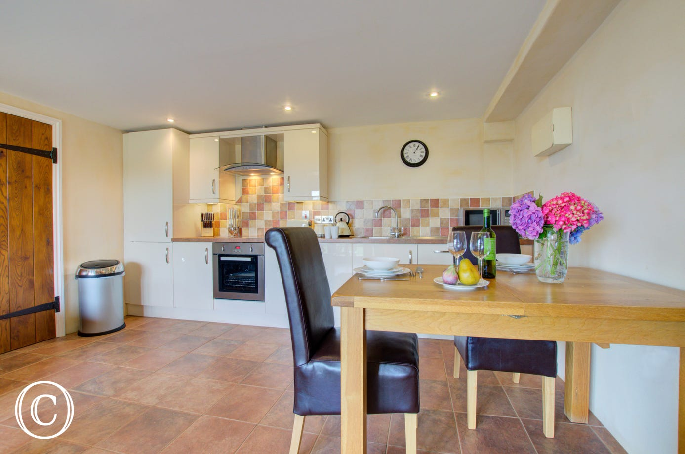 The kitchen is very well equipped and has a dining table for two