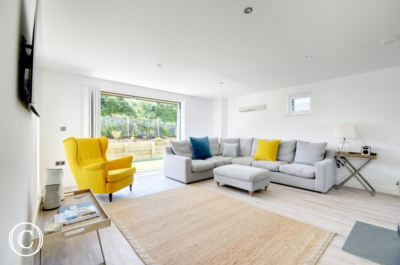 The impressive, bright and spacious open plan living area