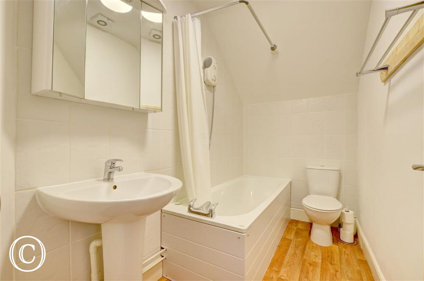 Good sized bathroom with bath and shower over bath